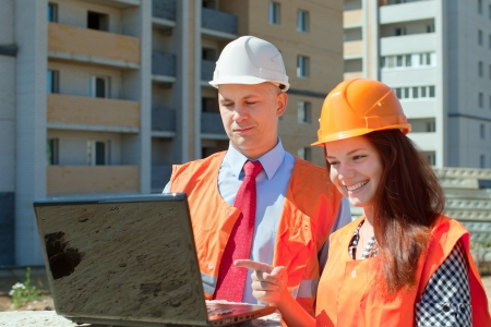 Portrait of two builders works at construction site Stock Photo - 17411651