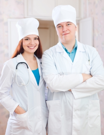 Portrait of friendly doctors in clinic interior photo