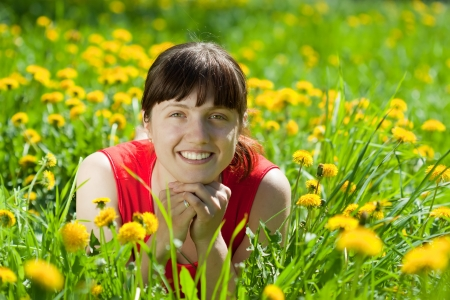 smiling  woman  relaxing outdoor in grass photo