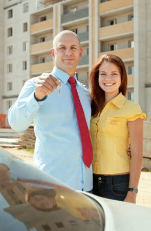 Happy couple with key against building new brick house Stock Photo - 17493159