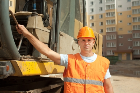 Portrait of tractor operator at construction site