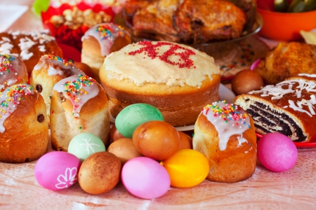 paskha: Easter cakes and other meal on festive table
