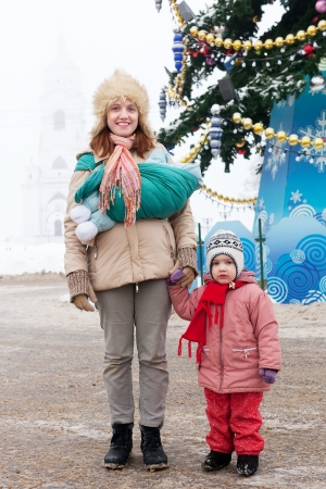 Portrait of happy mother with two children in Christmas time at Vladimir city, Russia photo