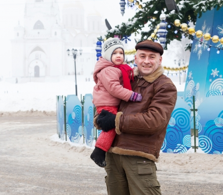 Portrait of happy father with child  in Christmas time at Vladimir city, Russia photo