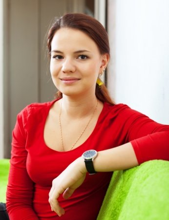 casualy: Portrait of tranquil beauty woman in red at home