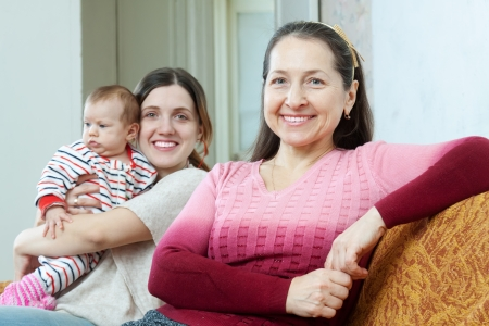 Happy mature woman and adult daughter with baby in home Stock Photo - 17592550