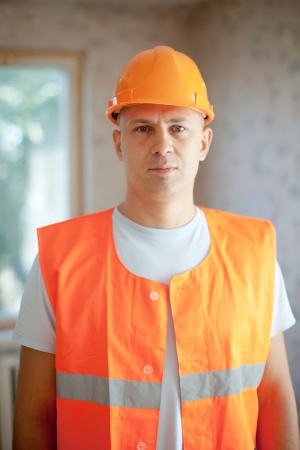 unskilled worker: Portrait of builder at new house