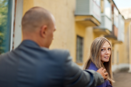 Man trying to get acquainted with a woman on the street Stock Photo - 17616767