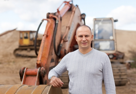 sand pit: Portrait of tractor operator at sand pit