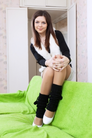 legwarmers: woman in spatterdashes at home interior