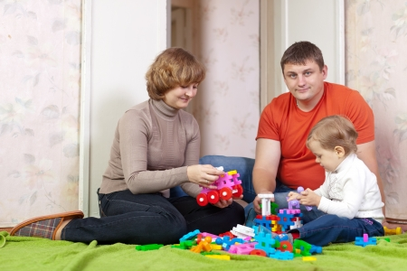 Family  plays with toys in home  photo