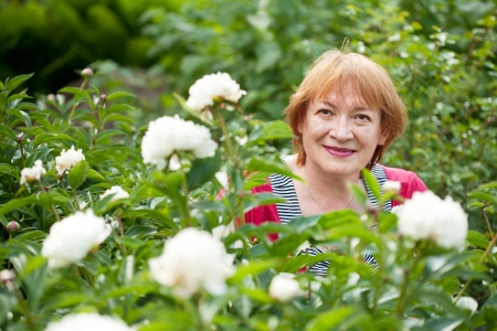 pion: mature woman in pion plant at garden Stock Photo