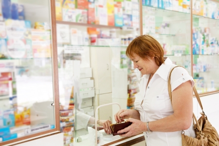 Mature woman buys drugs at the pharmacy Stock Photo - 17642056