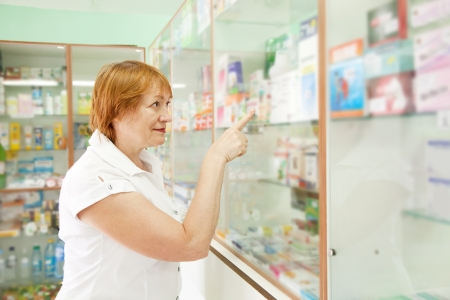 Mature woman near counter in pharmacy drugstore  photo