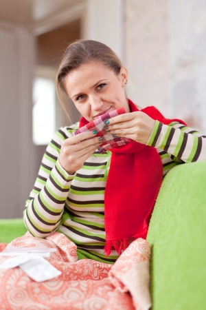 sick woman uses handkerchief in home Stock Photo - 17768022