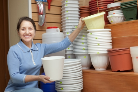 Mature woman chooses a flower pot in the store for gardeners Stock Photo - 17767333