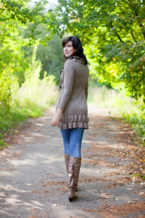 Full length shot of girl  in september park  photo