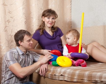 Happy parents with toddler in home inter Stock Photo - 17821508