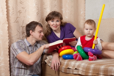 Family  relaxing with book at home Stock Photo - 17821514