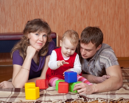 parents and child relaxing at home on floor Stock Photo - 17821506