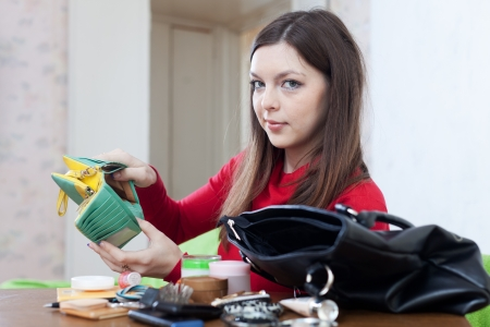woman can not finding anything in her purse Stock Photo - 17878212