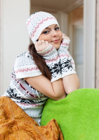 casualy: Pretty girl relaxing at home in winter