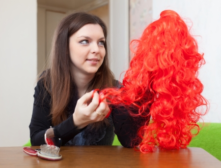 periwig:  brunette woman with red peruke at home