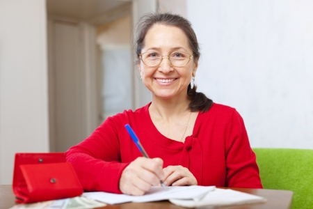 joyful woman fills in the questionnaire at  home Stock Photo - 17878698