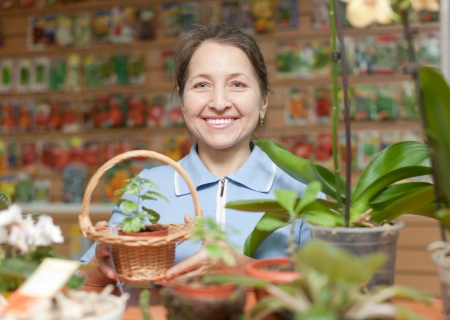 Smiling mature woman in  garden shop photo
