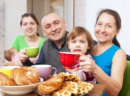 happy three generations family drinks tea with baked Stock Photo - 17887588
