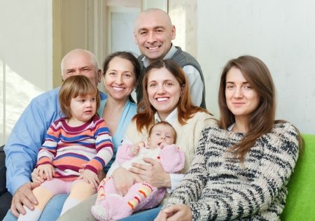Portrait of cheerful three generations family sits on sofa at home together Stock Photo - 17887571