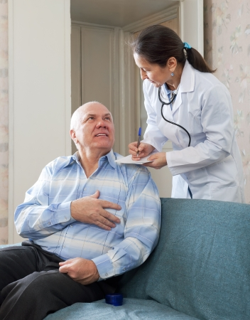 friendly doctor asks mature man feels at medical hospital photo