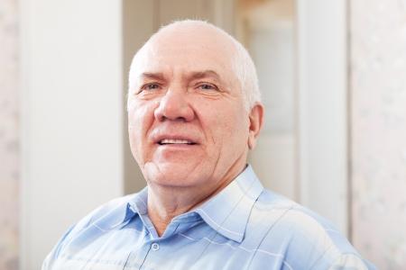 wistful: portrait of wistful grizzled senior man