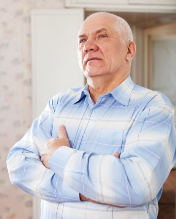 wistful: portrait of wistful grizzled elderly man in interior