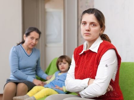Conflict between generations. Sad young woman against grandmother and child Stock Photo - 17926018