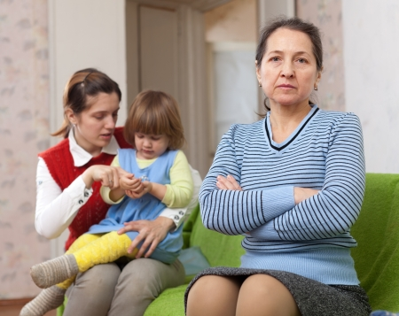 Mature woman and young mother with baby after quarrel at home Stock Photo - 17926001
