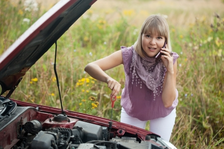 Young woman trying to fix the car Stock Photo - 18261808