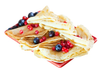 tasty pancakes with berries. Isolated over white background photo