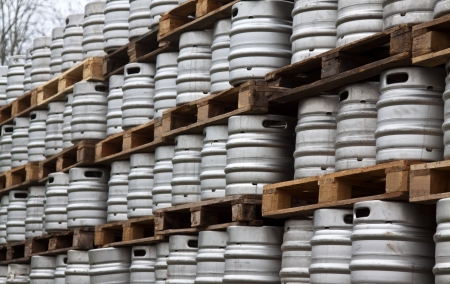 beer barrel: Beer kegs in rows outdoor Stock Photo