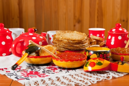 Russian Shrovetide table - pancake with caviar and tea photo