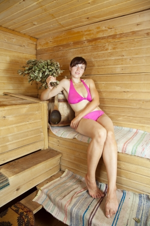 girl is steamed in the sauna with birch twigs Stock Photo - 18346046