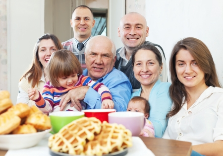 large joyful three generations family sits on sofa in livingroom at home Stock Photo - 18359671