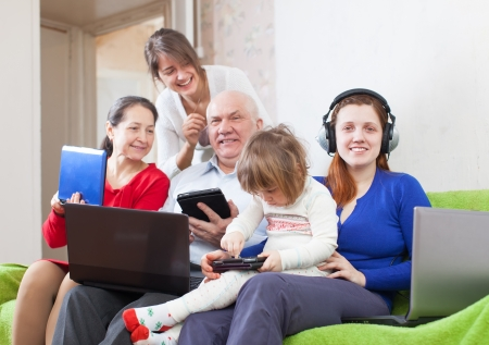 Happy multigenerations family  with laptops  at home Stock Photo - 18359654