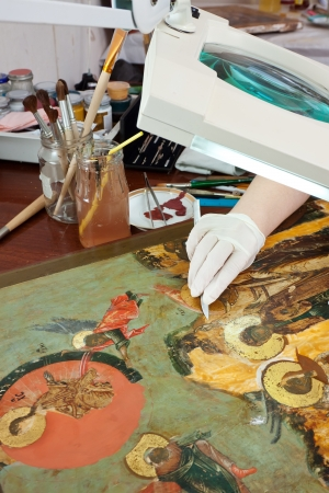 Closeup of  restoration of ancient icons in workshop photo
