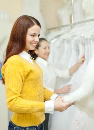 women choosing bridal dress at shop of wedding fashion Stock Photo - 18493269