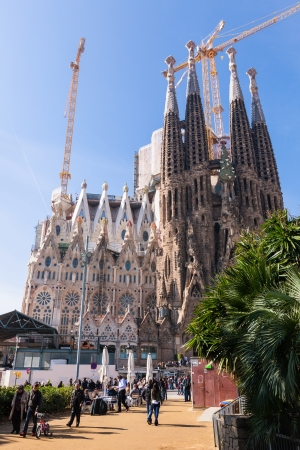 uncomplete: BARCELONA, SPAIN - MARCH 3: Sagrada Familia in March 3, 2013 in Barcelona, Spain. Basilica and Expiatory Church of the Holy Family by Gaudi, building is begun in 1882 and completion is planned in 2030  Editorial