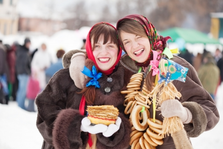 pancake week: Two happy girls celebrating  Pancake Week at Russia Stock Photo