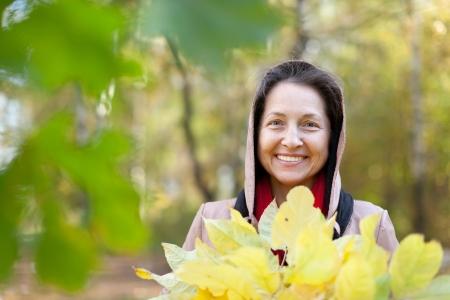 happy seasonable: Outdoor portrait of mature woman in autumn