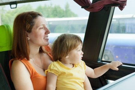 woman with her child in bus cabin photo