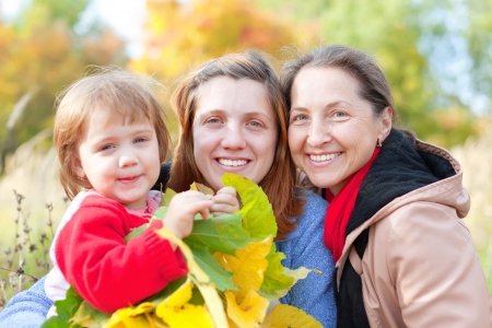 Portrait of three generations women in the autumn park Stock Photo - 18578124